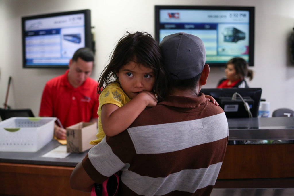 An immigrant father and child.