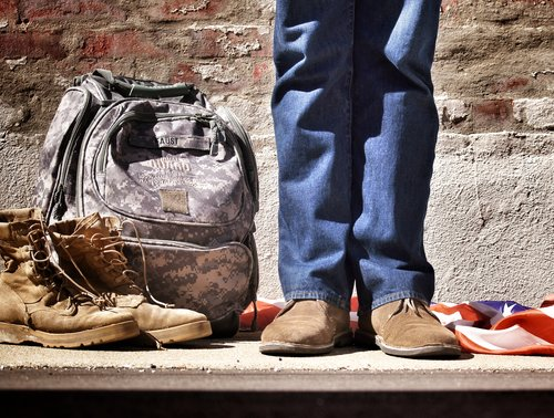 Man with military boots and backpack.