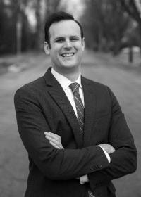 Max Crowley headshot in suit