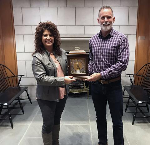 Photo of Cheri and Michael holding a mantel clock.
