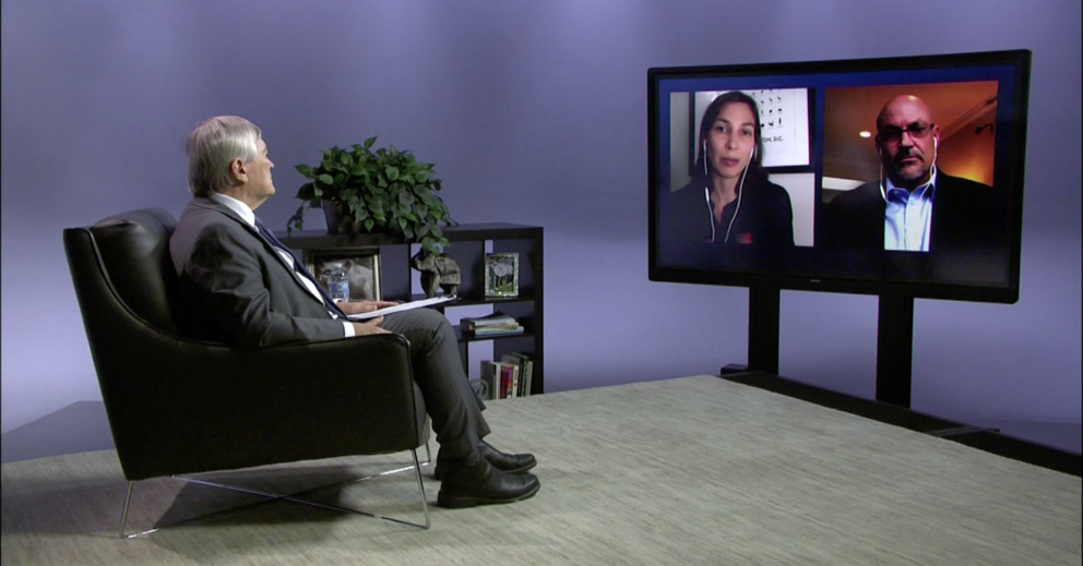 President Barron in studio with screen.