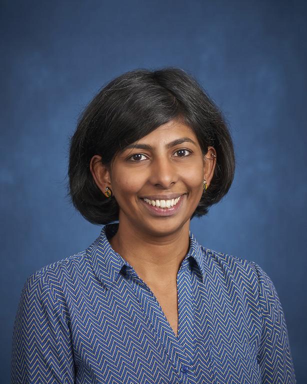 Gopalan headshot in blue blouse