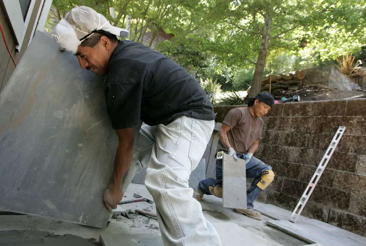 Landscape workers from Guatemala at a job in San Rafael, California