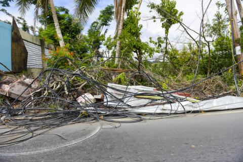 Photo from Hurricane Maria showing downed power lines and other debris.