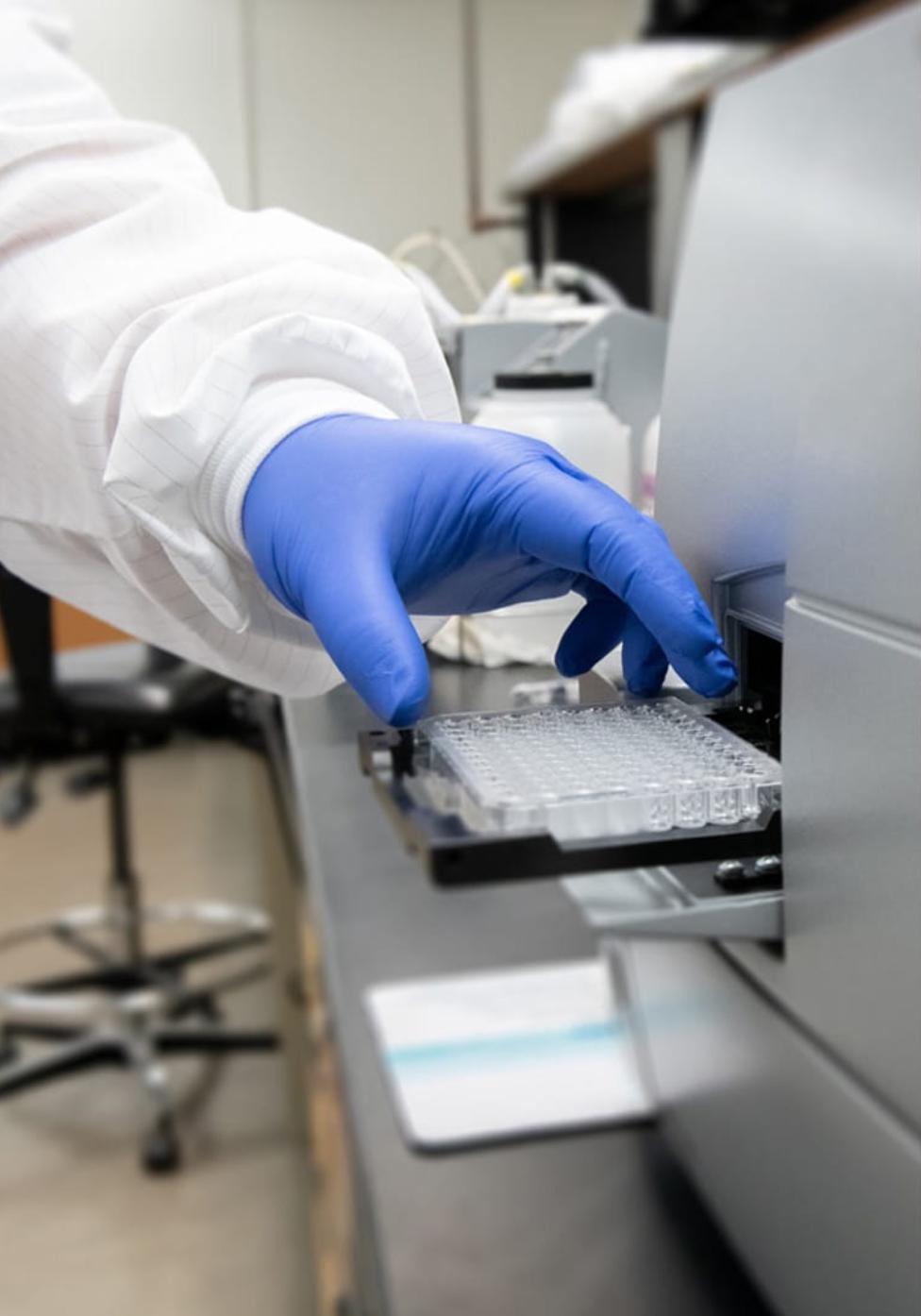 Researcher conducting antibody testing.