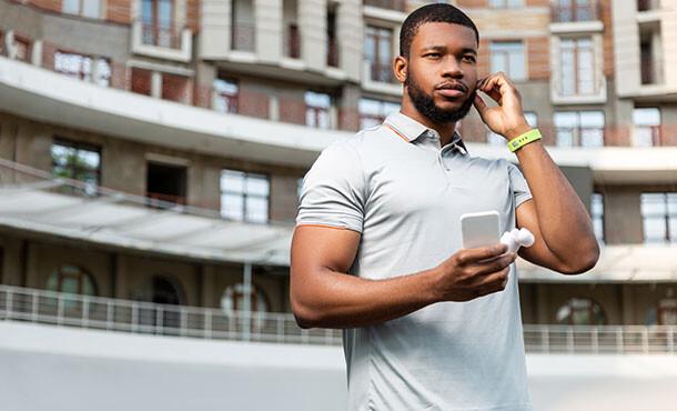 Man checking fitness tracker via cellphone