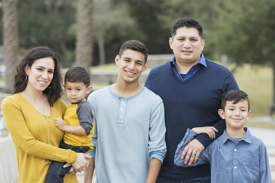 Hispanic family with three sons.