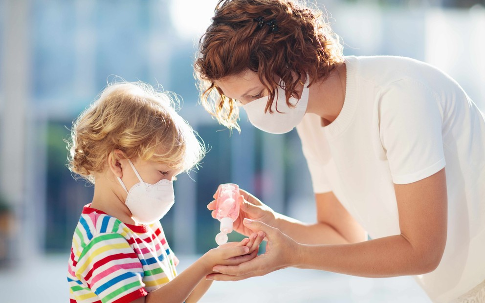 Mother and small child in face masks.