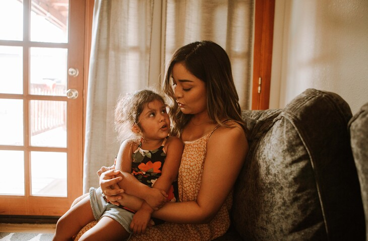 Mothrer and child sitting together