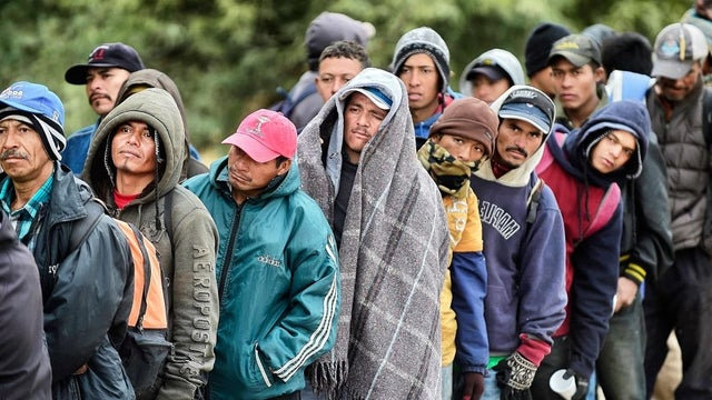 Undocumented immigrants in a line.
