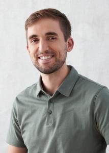 Headshot of Alex Winters, short brown hair, green short sleeved collared shirt.