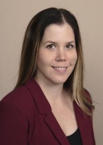 Headshot of Beth Long, medium length brown hair with burgandy blouse.