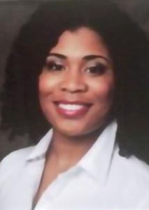 Headshot of Dawn Witherspoon with curly dark hair wearing a white dress shirt.