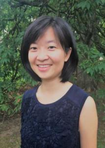 Headshot of Donghui Wang with mid-length, black hair wearing a black tank top.