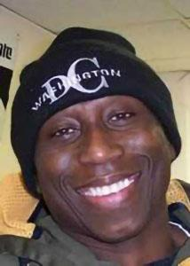 Headshot of Francis Dodoo wearing a black beanie hat in a casual setting.