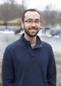 Hayward short hair, beard and blue sweatshirt