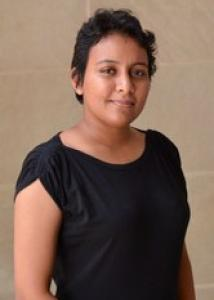 Jayasedera with short black hair and short sleeve black top