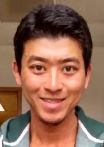 Headshot of Katsuya Oi indoors with brown eyes and short, dark hair wearing a striped top.