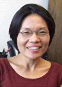 Headshot of Kyoungrae Jung with glasses and dark, short hair wearing a red top.