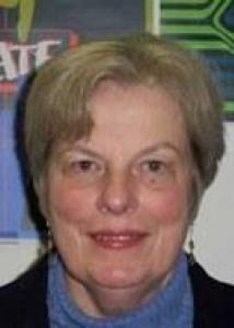 Headshot of Marylee with short gray hair, blue top, and black jacket.