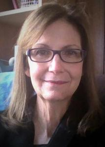 Headshot of Melissa Hardy with long, brown hair wearing glasses and black top.