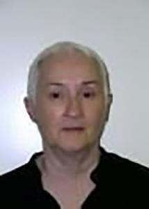 Headshot of Patricia with short white hair and black top.