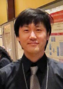 Headshot of Peter Kim with black hair, silver tie, and black shirt.