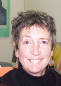 Headshot of Phyllis with short gray hair and black top.