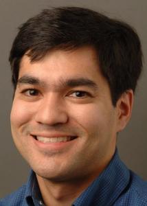 Headshot of Scott Yabiku with short, dark hair wearing a blue-collared shirt.
