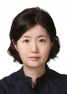 Headshot of Soomi Lee with mid-length black hair wearing a black top in front of white background.