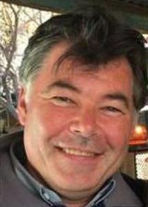 Headshot of Stephen Matthews outside with grey hair.