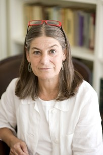 Photo of Lisa Berkman with long brownish gray hair and white blouse.
