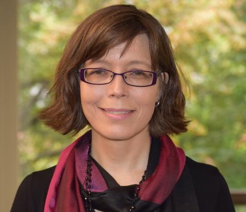 Hannum with short dark hair with dark glasses