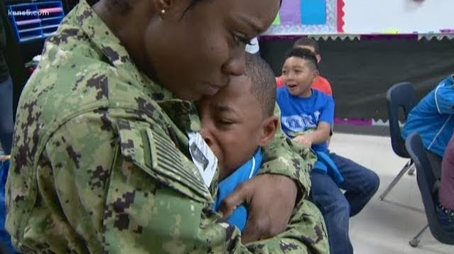 Photo of a military mom hugging her young son.