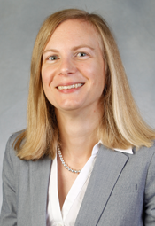 Headshot of Susan Brown with blonde hair, white blouse, and gray jacket.