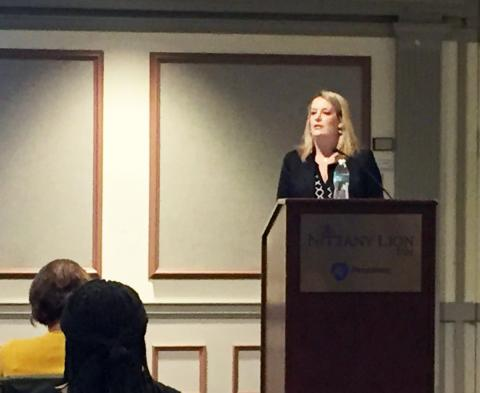 Photo of Shannon Monnat speaking at the conference.