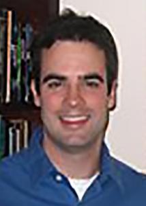 Headshot of David Puts with short black hair and a blue shirt.