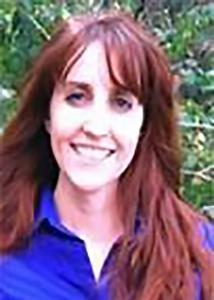 Headshot of Erin McMullen with long red hair and a blue blouse.