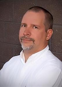 Headshot of H. Harrington Cleveland, III with grey, short hair wearing a white dress shirt.