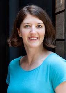 Headshot of Hannah Schreier with short brown hair and a light blue t-shirt.