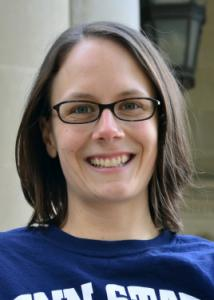 Headshot of Jessica Lougheed with short brown hair, glasses, and blue Penn State t-shirt.