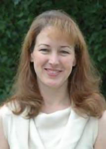 Headshot of Lisa Gatzke-Kopp with short light brown hair and white top.