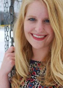 Headshot of Lizbeth Benson with long blonde hair and multi-colored floral top.