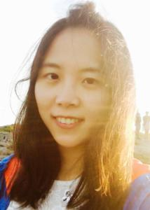 Headshot of Lu Ou with long black hair, white blouse, and blue jacket.
