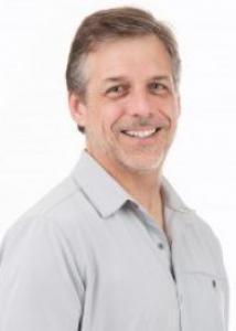 Headshot of Martin Sliwinski with short brown hair in light gray shirt.
