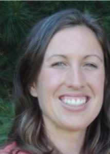 Megan Mucioki head shot with brown hair smiling