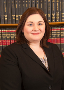 Melissa Krug in black suit with books