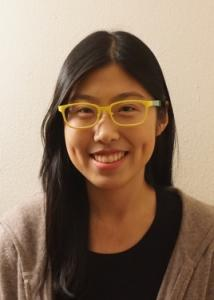 Headshot of Meng Chen with long black hair, glasses, black top, and gray sweater.
