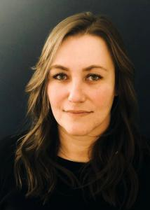 Headshot of Mindi Weidow with long light brown hair and black blouse.