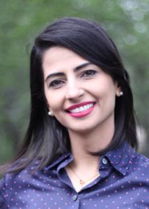 Headshot of Saeideh Heshmati with black hair and purple blouse.